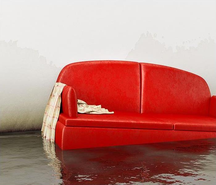 Living room with red couch floating in a shallow pool of water