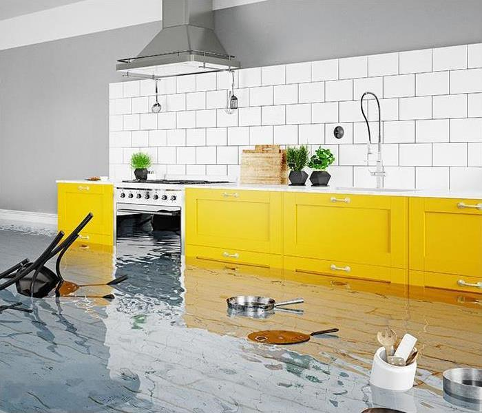 kitchen with yellow cabinets and water pooled on the floor and floating pans